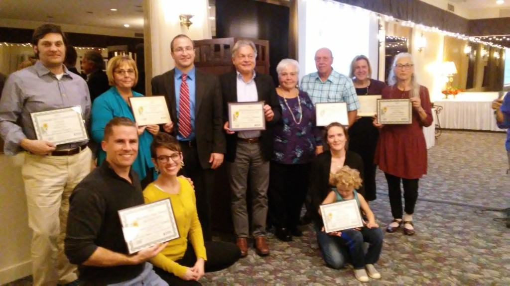 2017 Community Beautification Award Winners Back row, l-r: Michael Sampson, Greentree Garden Supply; Donna Tangorre and John Strong, Elmira Savings Bank; Paul Mazzarella, Ithaca Neighborhood Housing Services; Linda and Larry Stilwell, Enfield Fire Department; Gail Lyman, Ithaca Rotary Club; Seph Doliner, Utica Street.  Front row, l-r: Sarah and Brandon Brylinsky, Marshall Street; Jeanne Grace (with son Oliver), Ithaca City Forester